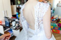 Lacing on a wedding dress royalty free stock image