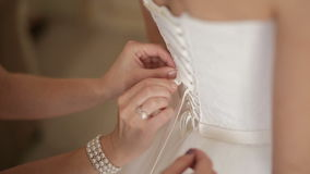 Lacing wedding dress stock video