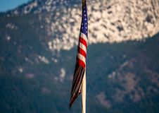 With a Lack of Breeze Old Glory Hangs Limp. The American flag hangs tranquil in the calm of the afternoon Royalty Free Stock Image