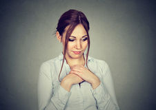 Lack of confidence. Shy woman feels awkward Royalty Free Stock Images