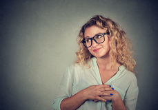 Lack of confidence. Shy young woman feels awkward Royalty Free Stock Photography