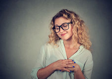 Lack of confidence. Shy young woman feels awkward Stock Photo