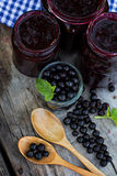 Вlack currant jam. On the old table Royalty Free Stock Photo