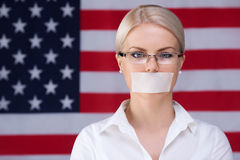 Lack of freedom. Young woman with mouth taped Royalty Free Stock Photo