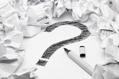 Lack of inspiration. Question mark in the middle if crumpled papers - lack of inspiration concept Royalty Free Stock Photography