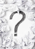 Lack of inspiration. Question mark in the middle if crumpled papers - lack of inspiration concept Royalty Free Stock Photo