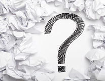Lack of inspiration. Question mark in the middle if crumpled papers - lack of inspiration concept Royalty Free Stock Image