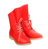 Lack red modern pair of shoes. Red high winter autumn shoes. Modern pair of lack boots isolated on white Royalty Free Stock Image