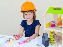 Lack-Rolle mit Lackproben Haus im Bau Lizenzfreies Stockbild