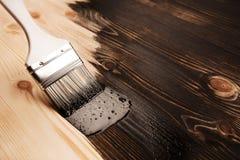 Lacka naturligt trä arkivfoton