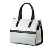 Lacklederhandtasche mit den Schwarzgriffen lokalisiert auf Weiß Lizenzfreie Stockfotos