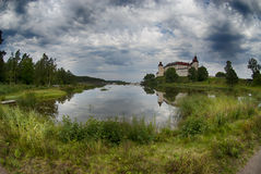 Lacko castle. Dramatic sky over Lacko castle in Sweden Stock Image