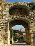 Lacoste, France, through archway. Ancient buildings in Lacoste, France, viewed through a double archway Stock Images