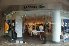 Lacoste Store at the Ala Moana Center. HONOLULU - AUGUST 7, 2014: Lacoste Store at the Ala Moana Center Is a French clothing company founded in 1933 that sells stock image