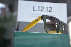 Lacoste Yellow Black Sunglasses Stock Photo