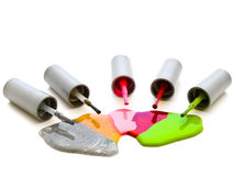 Lacquer. Photo of the multicolored liquid lacquer over white background Royalty Free Stock Image