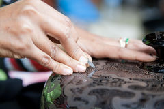 Lacquer manufacture. In Bagan, Burma. Woman is engraving by lancet motive to lacquer surface Stock Photo