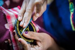 Lacquer manufacture in Bagan, Myanmar. Woman is engraving by lancet motive to lacquer surface Royalty Free Stock Photography