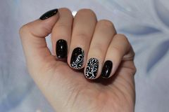 Beautiful well-groomed nails with an interesting design Royalty Free Stock Photography