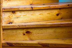 Fragment of the wood spiral staircase close-up. Royalty Free Stock Image