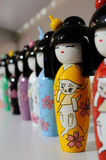 Lacquered wood dolls Stock Images