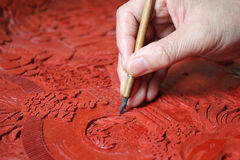 Lacquerware Carving. An artist is carving lacquerware at workplace Stock Photography