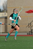 Lacroose check from behind. High School girls varsity lacrosse player checked from behind Stock Photo