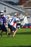 Lacrosse über der Schulter erwischen Stockbild