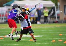 Lacrosse 5to/6to de Chumash de la juventud Imagenes de archivo