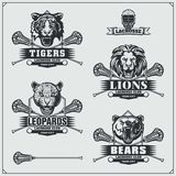 Lacrosse badges, labels and design elements. Sport club emblems with bear, lion, tiger and leopard. Vector royalty free illustration