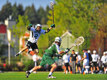 Lacrosse blocking goalie stock image