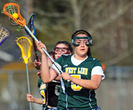 Lacrosse check from behind Royalty Free Stock Photography