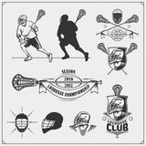 Lacrosse club labels, emblems, design elements and silhouettes of the players. Black and white Stock Photography