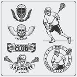 Lacrosse club labels, emblems, design elements and silhouettes of the players. Black and white Royalty Free Stock Images