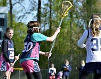 Lacrosse das raparigas Fotografia de Stock Royalty Free