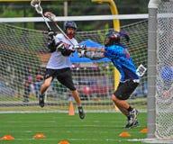 Lacrosse de Chumash tiré sur le but Photos stock