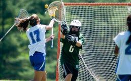Lacrosse de filles de lycée images libres de droits
