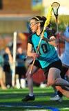 Lacrosse de las muchachas en el movimiento Fotografía de archivo