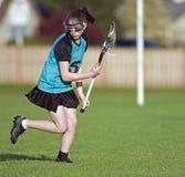 Lacrosse die haar flank controleert Stock Afbeeldingen