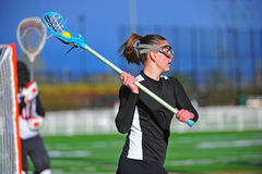 Lacrosse girl player ready to pass Stock Photo