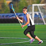 Lacrosse girl player running Royalty Free Stock Photography