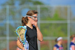 Lacrosse girl thinking Royalty Free Stock Photo