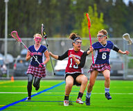Lacrosse girls coming to a stop Royalty Free Stock Photos