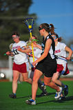 Lacrosse girls cradling the ball Royalty Free Stock Image