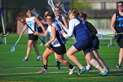 Lacrosse girls defending the goal Royalty Free Stock Photography