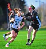 Lacrosse girls defense  Royalty Free Stock Photo