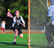 Lacrosse girls freshman shot on goal Royalty Free Stock Photos
