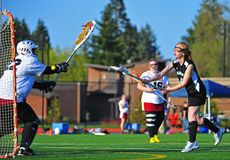 Lacrosse girls getting by the goalie Royalty Free Stock Image