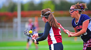 Lacrosse girls illegal check Royalty Free Stock Images