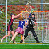 Lacrosse girls on the move Royalty Free Stock Photos